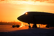 Alaska. Fairbanks International Airport. A comercial jet airplane at sunset.