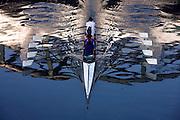 Quad scud boat of Canottieri Milano (Rowing society) during a training on Naviglio Grande (canal) in Milan, April, 2011. © Carlo Cerchioli..Un barca di canottaggio, quattro di coppia femminile, della Canottieri Milano in allenamento lungo il Naviglio Grande a Milano, aprile 2011.