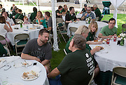 "Elliot Strunk, center, and another member of the Ohio University alumni community chat  at a barbecue on the College Green on May 31, 2014. The event, for Ohio University alumni and their families, was part of the ""On The Green"" weekend, which was hosted by the Ohio University Alumni Association. Photo by Lauren Pond"