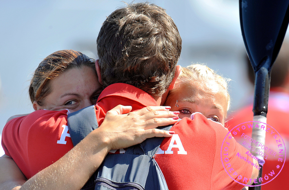 MARTA WALCZYKIEWICZ & EWELINA WOJNAROWSKA (BOTH POLAND) WITH THEIR TRAINER COACH CELEBRATE THEIR SILVER MEDAL IN WOMEN'S K2 200 METERS FINAL A RACE DURING 2010 ICF KAYAK SPRINT WORLD CHAMPIONSHIPS ON MALTA LAKE IN POZNAN, POLAND...POLAND , POZNAN , AUGUST 22, 2010..( PHOTO BY ADAM NURKIEWICZ / MEDIASPORT ).
