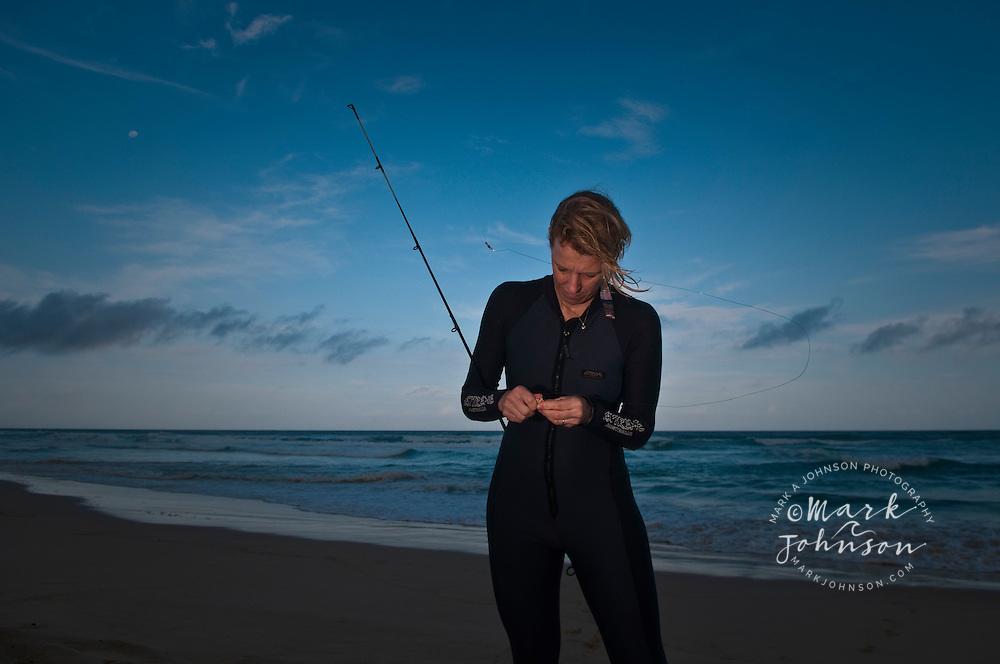 Woman beach fishing, Moreton Island, Queensland, Australia