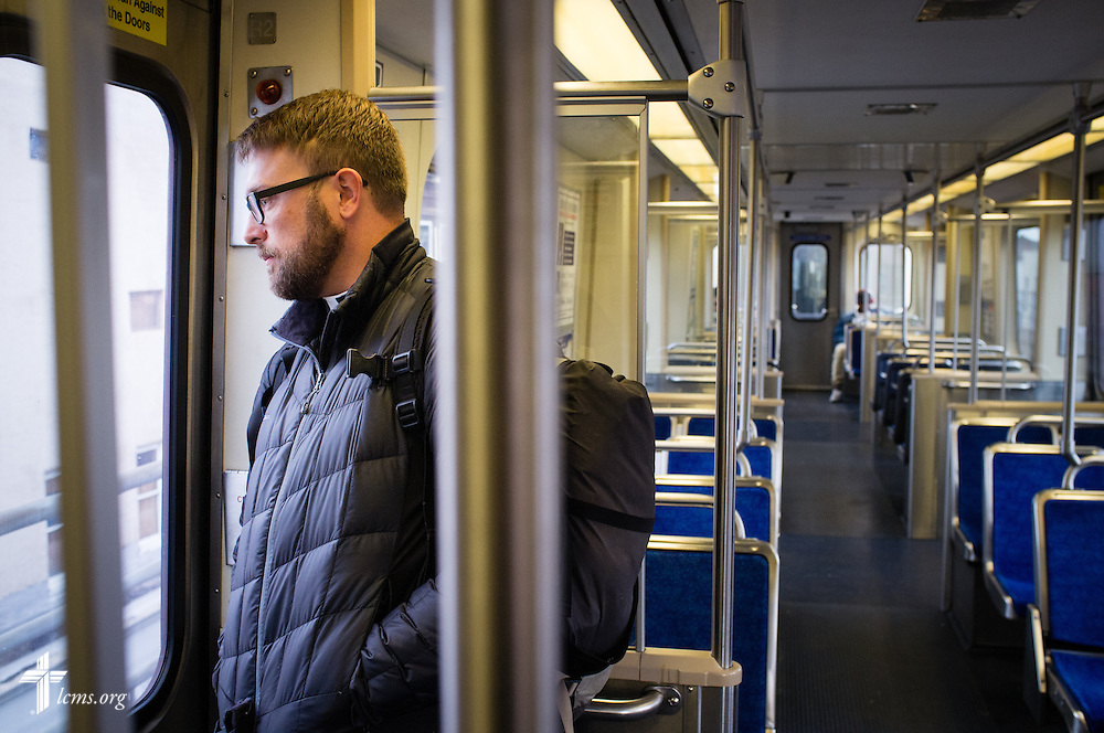The Rev. Adam DeGroot, new national missionary and pastor at Shepherd of the City Lutheran Church, rides a train on Monday, Nov. 2, 2015, to downtown Philadelphia.  LCMS Communications/Erik M. Lunsford