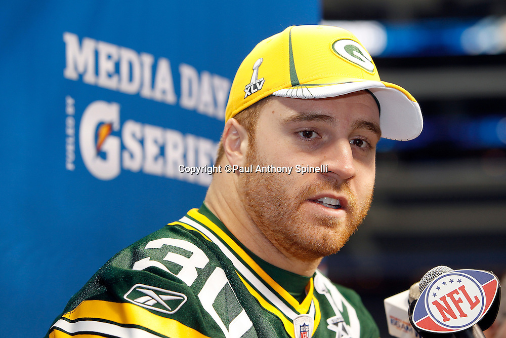 Green Bay Packers fullback John Kuhn (30) speaks to the press at Super Bowl XLV media day prior to NFL Super Bowl XLV against the Pittsburgh Steelers. Media day was held on Tuesday, February 1, 2011 in Arlington, Texas. ©Paul Anthony Spinelli