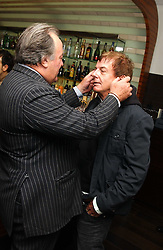 Left to right, SIR DAI LLEWELLYN and NICKY HASLAM at a party to celebrate the opening of Maze - a new Gordon Ramsay restaurant at 10-13 Grosvenor Square, London W1 on 24th May 2005.<br />