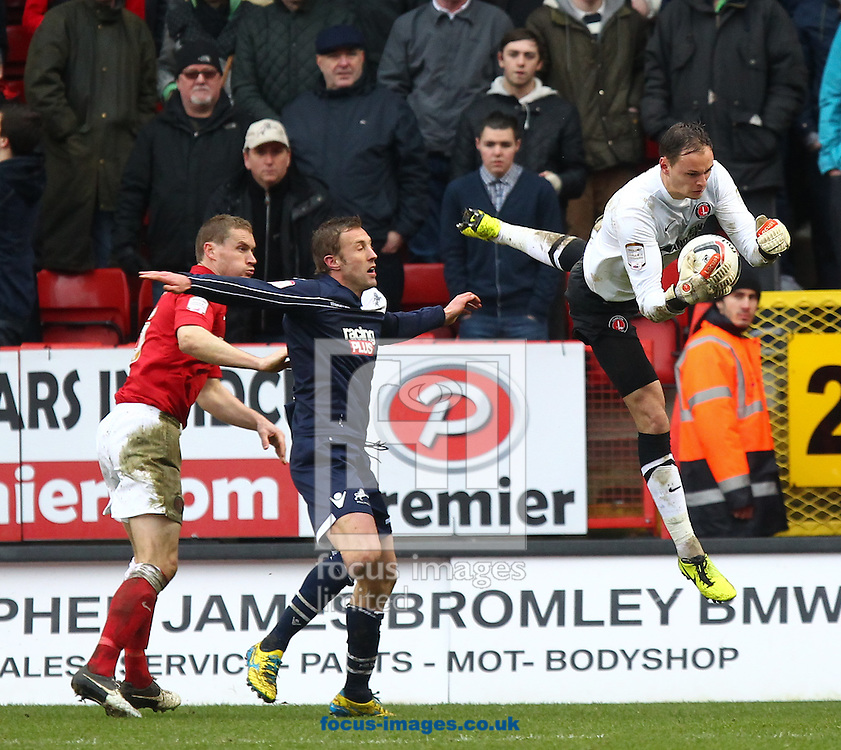 Picture by John  Rainford/Focus Images Ltd +44 7506 538356.16/03/2013.David Button of Charlton Athletic saves in front Rob Hulse of Millwall during the npower Championship match at The Valley, London.
