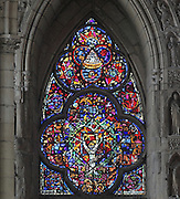 Stained glass window possibly depicting the Tree of Jesse with the genealogy of the animals, 1220-30, in the South side aisle of the Cathedrale Notre-Dame de Reims or Reims Cathedral, Reims, Champagne-Ardenne, France. The cathedral was built 1211-75 in French Gothic style with work continuing into the 14th century, and was listed as a UNESCO World Heritage Site in 1991. Picture by Manuel Cohen