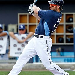 March 21, 2012; Port Charlotte, FL, USA; Tampa Bay Rays left fielder Luke Scott (30) hits a fly out against the New York Yankees during the bottom of the first inning of a spring training game at Charlotte Sports Park.  Mandatory Credit: Derick E. Hingle-US PRESSWIRE