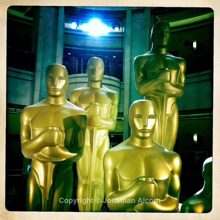 Giant Oscar statues outside the Kodak Theater on the day before the 2011 Academy Awards.