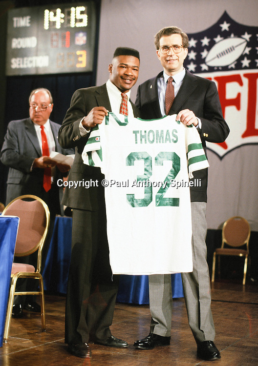 Number two overall draft pick New York Jets running back Blair Thomas (32) holds up his new team jersey while posing for a photo with NFL Commissioner Paul Tagliabue at the 1990 NFL Draft on April 22, 1990 in New York. (©Paul Anthony Spinelli)