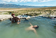 Andrew, left, and David Toro relax in a natural hot spring in Mammoth Lakes, Calif., on May 12, 2013.