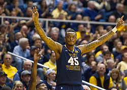 West Virginia Mountaineers forward Elijah Macon (45) celebrates a made three pointer late in the second half against Oklahoma State at the WVU Coliseum.