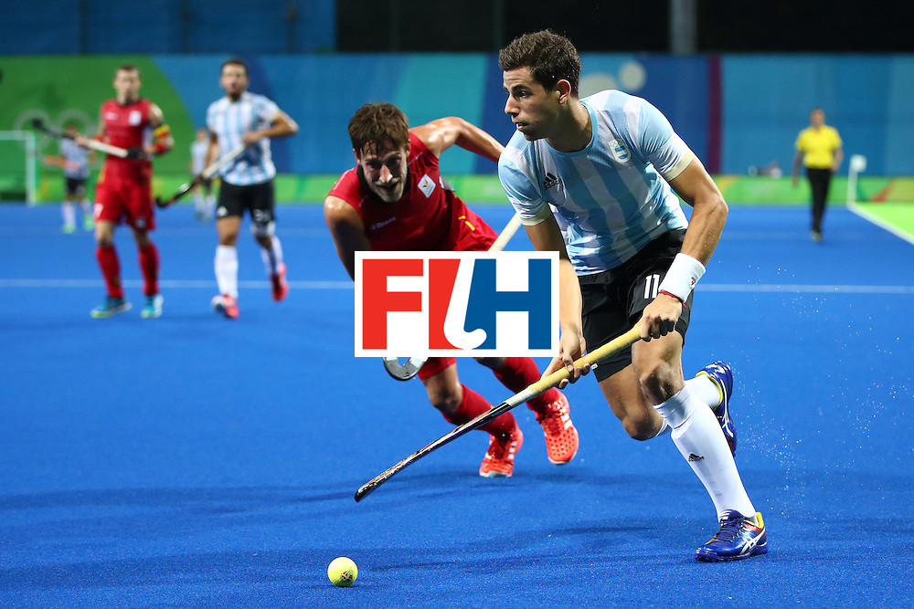 RIO DE JANEIRO, BRAZIL - AUGUST 18:  Joaquin Harmotto Menini #11 of Argentina in action during the Men's Hockey Gold Medal match between Belgium and Argentina on Day 13 of the Rio 2016 Olympic Games at Olympic Hockey Centre on August 18, 2016 in Rio de Janeiro, Brazil.  (Photo by Clive Brunskill/Getty Images)