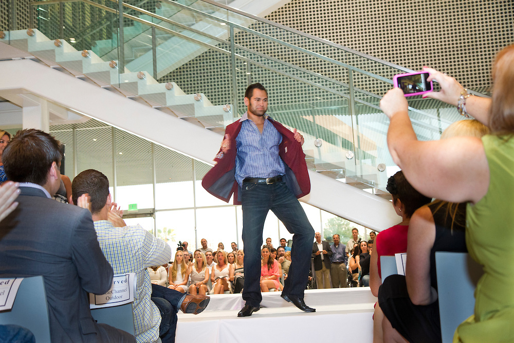 TP_340310_FREE_RAYSRUNWAY_..Caption:(Wednesday 06/29/2011 Tampa)Johnny Damon does a little dance as members of the Tampa Bay Rays and their wives walk the runway escorting children with life-threatening illnesses during the annual Rays on the Runway fashion event at the Tampa Museum of Art on Wednesday, June 29, to benefit the Children's Dream Fund. The show featured fashions by Saks Fifth Avenue. ..Summary:Tampa Bay Rays and their wives walk the runway escorting children with life-threatening illnesses during the annual Rays on the Runway fashion event at the Tampa Museum of Art...Photo by James Branaman