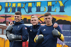 Boxing Twins Pat (left), Luke McCormack (right) and Callum French pose for a photo at Birtley boxing club, Gateshead.