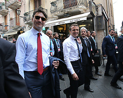 May 26, 2017 - Taormina, Italy - Prime Minister of Canada JUSTIN TRUDEAU and President-elect EMMANUEL MACRON outside walking  at the G7 Taormina summit on the island of Sicily. Leaders of the G7 group of nations, which includes the Unted States, Canada, Japan, the United Kingdom, Germany, France and Italy, as well as the European Union, are meeting at Taormina from May 26-27. (Credit Image: © Gabriele Maricchiolo/NurPhoto via ZUMA Press)