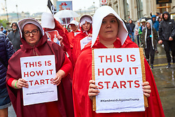© Licensed to London News Pictures. 04/06/2019. LONDON, UK.  Protesters dressed as Handmaids from The Handmands Tale to in Whitehall during day 2 of the state visit of President Donald Trump to the UK. The group are highlighting recent abortion lawas passed in some parts of America.  Photo credit: Cliff Hide/LNP