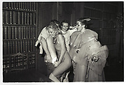 Paul Golding looks on as Katie removes trousers. Piers Gaveston drinks. Rhodes House. Oxford. 1980, Oxford: The Last Hurrah. Negative scans.