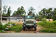 24 OCTOBER 2012 - PATTANI, PATTANI, THAILAND:  Royal Thai Army armored cars on the road in Pattani, Thailand. More than 5,000 people have been killed and over 9,000 hurt in more than 11,000 incidents, or about 3.5 a day, in Thailand's three southernmost provinces and four districts of Songkhla since the insurgent violence erupted in January 2004, according to Deep South Watch, an independent research organization that monitors violence in Thailand's deep south region that borders Malaysia. Muslim extremists are battling the Thai government and its symbols, like schools and Buddhist facilities.    PHOTO BY JACK KURTZ