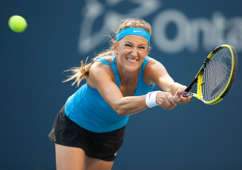 Victoria Azarenka of Belarus returns a shot during her semi-final match  against Serena Williams of the United States at the Rogers Cup WTA event in Toronto, Ontario, August 13, 2011. Williams defeated Azarenka in straight  sets.<br /> AFP PHOTO/Geoff Robins