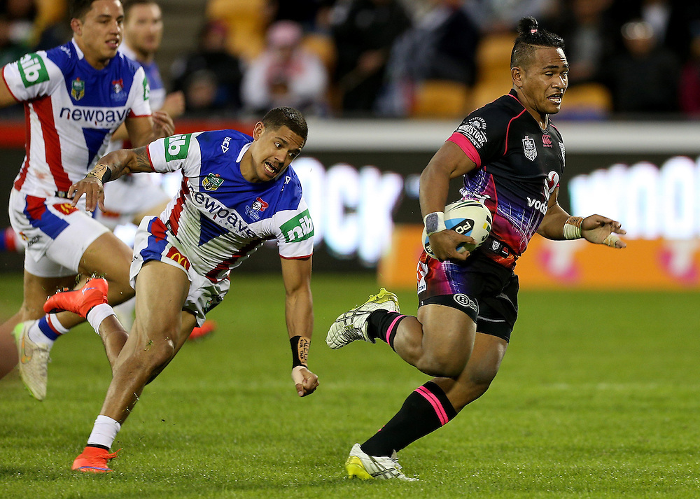 Solomone Kata of the New Zealand Warriors is chased by Dane Gagai of the Newcastle Knights during their round 12 NRL match at Mount Smart Stadium, Auckland on  Sunday, May 31, 2015. Credit: SNPA / David Rowland