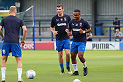 AFC Wimbledon midfielder Mitchell (Mitch) Pinnock (11), AFC Wimbledon Kyron Stabana (14) and AFC Wimbledon attacker Adam Roscrow warming up during the Pre-Season Friendly match between AFC Wimbledon and Brentford at the Cherry Red Records Stadium, Kingston, England on 5 July 2019.