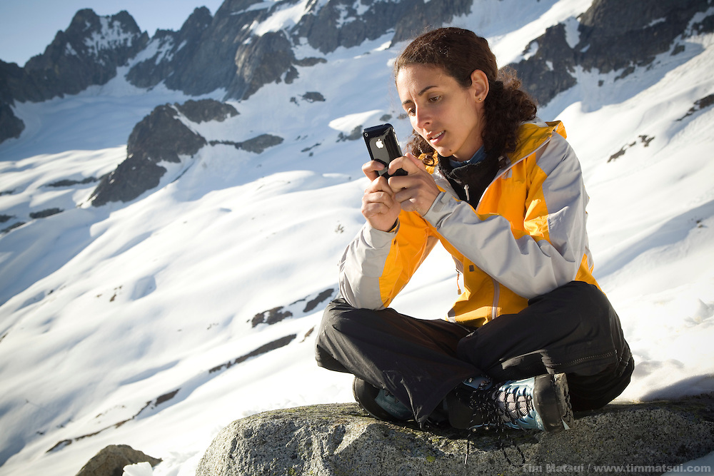 THIS PHOTO IS AVAILABLE EXCLUSIVELY FROM AURORA PHOTOS; LICENSING MUST GO THROUGH AURORA.<br /> Visit Aurora and Keyword &quot;Tim Matsui&quot; <br /> http://www.auroraphotos.com / +1.207.828.8787<br /> <br /> Latina woman camps and backpacks in the snowy mountains.
