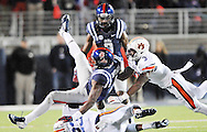 Ole Miss' wide receiver Laquon Treadwell (1) is tackled by Auburn Tigers' defensive back Johnathan Ford (23) and Auburn Tigers' defensive back Jonathan Jones (3) at Vaught-Hemingway Stadium in Oxford, Miss. on Saturday, November 1, 2014. (AP Photo/Oxford Eagle, Bruce Newman)
