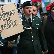U.S. Army solider Brandon Burton marches with thousands of Occupy Seattle protesters in the streets of downtown Seattle during the second week of the local protest held in solidarity with the Occupy Wall Street protest in New York City. The marchers gathered at Bank of America Fifth Avenue Plaza  and for a short time occupied a downtown intersection. Two were arrested when they refused police orders to move from the intersection. Photographed on Saturday, October 8, 2011. (Joshua Trujillo, seattlepi.com)