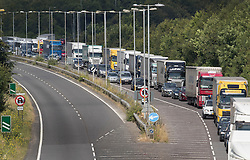 © Licensed to London News Pictures. 23/07/2016. Dover, UK.  Cars and trucks queue up to get into the port of Dover. Long delays are currently being experienced after increased security checks were put in place. Photo credit: Peter Macdiarmid/LNP