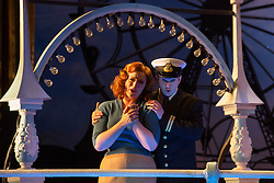 "© Licensed to London News Pictures. 14/05/2014. London, England. Pictured: Kate Valentine as Fiordiligi and Marcus Farnsworth as Guglielmo. Dress rehearsal of the Wolfgang Amadeus Mozart opera ""Così fan tutte"" at the London Coliseum. A new ENO production of Mozart's dark comedy set in the world of a 1950's Coney Island funfair. With Kate Valentine as Fiordiligi, Christine Rice as Dorabella, Marcus Farnsworth as Guglielmo, Randall Bills as Ferrando, Mary Bevan as Despina and Roderick Williams as Don Alfonso. Directed by Phelim McDermott, Conductor: Ryan Wigglesworth. Co-produced by the English National Opera and the Metropolitan Opera, New York. In collaboration with Improbable. 12 performances from 16 May to 6 July 2014. Photo credit: Bettina Strenske/LNP"