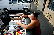 MELISSA LYTTLE   |   Times<br /> SP_345156_LYTT_MOTEL_11 (November 22, 2011, St. Petersburg, FL) With clothes crammed into plastic garbage bags and cleaning supplies stuffed in buckets and her four-year-old's toys shoved in a box, Laurie Hathaway loads up her aunt's truck with all the belongings they'd crammed into Room 88, after falling three days behind on her room payment at the Mosley Motel. [MELISSA LYTTLE, Times]