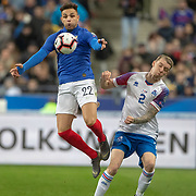 PARIS, FRANCE - March 25:  Layvin Kurzawa #22 of France wins the ball while challenged by Birkir Mar Sævarsson #2 of Iceland during the France V Iceland, 2020 European Championship Qualifying, Group Stage at  Stade de France on March 25th 2019 in Paris, France (Photo by Tim Clayton/Corbis via Getty Images)