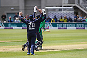 Sam Billings and Jason Roy of England celebrate the wicket of George Dockrell of Ireland, lbw during the One Day International match between England and Ireland at the Brightside County Ground, Bristol, United Kingdom on 5 May 2017. Photo by Andrew Lewis.