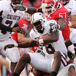 Oct 10, 2009; Piscataway, NJ, USA; Texas Southern quarterback Arvell Nelson (8) is tackled by Rutgers defensive end Sorie Bayoh (57) and defensive end Jonathan Freeny (99) during second half NCAA college football action in Rutgers' 42-0 victory over Texas Southern at Rutgers Stadium.