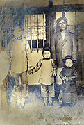 severely deteriorating mixed Japanese and Chinese family portrait early 1900s