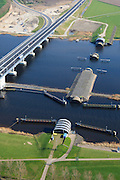 Nederland, Flevoland-Overijssel, Ramspol, 01-05-2013; de balgstuw in het Ramsdiep met strekdam naast de nieuwe Ramspolbrug in de N50 .<br /> Ramspol, inflatable dike, between Ketelmeer and Black Water. The Balgstuw (bellow barrier) is a storm barrier and consists of an inflatable dam or dyke, composed of three bellows. Usually, each bellow rests on the bottom of the water, but now the bellows are inflated  because of maintenance.<br /> luchtfoto (toeslag op standard tarieven)<br /> aerial photo (additional fee required)<br /> copyright foto/photo Siebe Swart