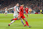GOAL 1-1 Bayern Munich midfielder Serge Gnabry (22) shoots at goal and Liverpool defender Joel Matip (32) (not in picture) deflects the ball into the net during the Champions League match between Bayern Munich and Liverpool at the Allianz Arena, Munich, Germany, on 13 March 2019.