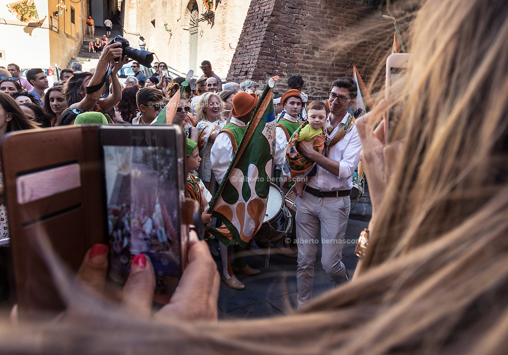 Italy, Siena, the Palio: the day before the Palio in everfy contrada new borns are baptized