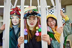 "© Licensed to London News Pictures. 15/01/2018. LONDON, UK. Zongxiu Xie, Yiwei Shi and Yuxuan Wang present ""Birdcage - Zootudio"".  Students from Central Saint Martins, UAL, take part in the opening of Studio Complex, the second year of the Tate Exchange Associates programme at Tate Modern, presenting interactive works examining what it takes to survive as an artist in contemporary London.  Studio Complex runs 15 to 21 January. Photo credit: Stephen Chung/LNP"