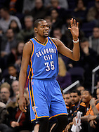 Jan. 14, 2013; Phoenix, AZ, USA; Oklahoma City Thunder forward Kevin Durant (35) reacts on the court during the game against the Phoenix Suns at the US Airways Center. The Thunder defeated the Suns 102-90. Mandatory Credit: Jennifer Stewart-USA TODAY Sports