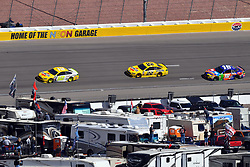 March 4, 2018 - Las Vegas, NV, U.S. - LAS VEGAS, NV - MARCH 04: Ryan Blaney (12) Team Penske Ford Fusion, Joey Logano (22) Team Penske Pennzoil Ford Fusion, and Kyle Busch (18) Joe Gibbs Racing (JGR) Toyota Camry drive into turn 4 during the Monster Energy NASCAR Cup Series Pennzoil 400 on March 04, 2018 at Las Vegas Motor Speedway in Las Vegas, NV. (Photo by Chris Williams/Icon Sportswire) (Credit Image: © Chris Williams/Icon SMI via ZUMA Press)