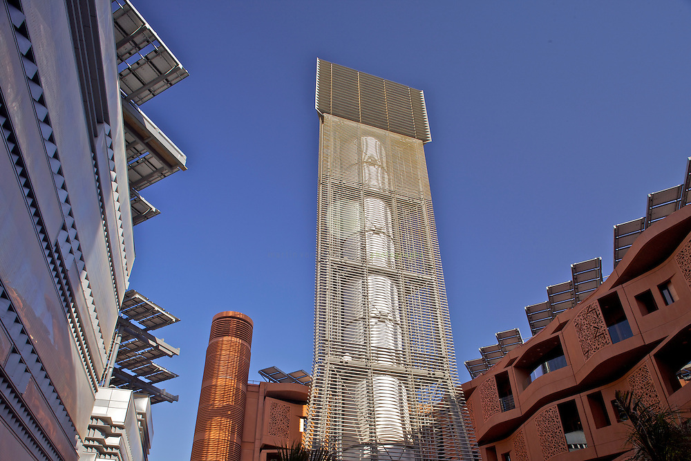 Masdar City is a project in Abu Dhabi, in the United Arab Emirates. Its core is a planned city, which is being built by the Abu Dhabi Future Energy Company, a subsidiary of Mubadala Development Company, with the majority of seed capital provided by the government of Abu Dhabi. Designed by the British architectural firm Foster and Partners and engineering and environmental consultancy Mott MacDonald, the city will rely entirely on solar energy and other renewable energy sources, with a sustainable, zero-carbon, zero-waste ecology and will be a car free city. The city is being constructed 17 kilometres east-south-east of the city of Abu Dhabi, beside Abu Dhabi International Airport.