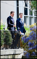 British Prime Minister David Cameron and the Deputy Prime Minister Nick Clegg during a joint press conference in the garden of Downing Street, London, UK, Wednesday May 12, 2010. Photo By Andrew Parsons / i-Images.