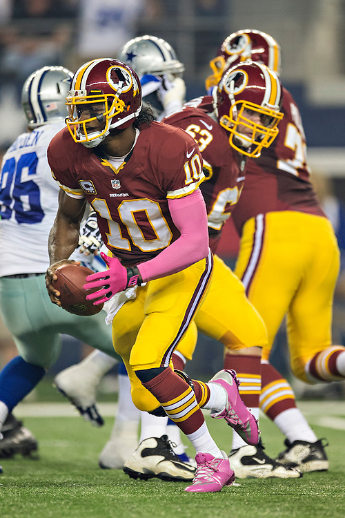 ARLINGTON, TX - OCTOBER 13:  Robert Griffin III #10 of the Washington Redskins drops back to make a hand off against the Dallas Cowboys at AT&T Stadium on October 13, 2013 in Arlington, Texas.  The Cowboys defeated the Redskins 31-16.  (Photo by Wesley Hitt/Getty Images) *** Local Caption *** Robert Griffin III