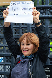 """Protester Pat, a woman in her """"late fifties"""" from North London demands that Parliament open its gates and lets democracy back in. London, September 24 2019."""
