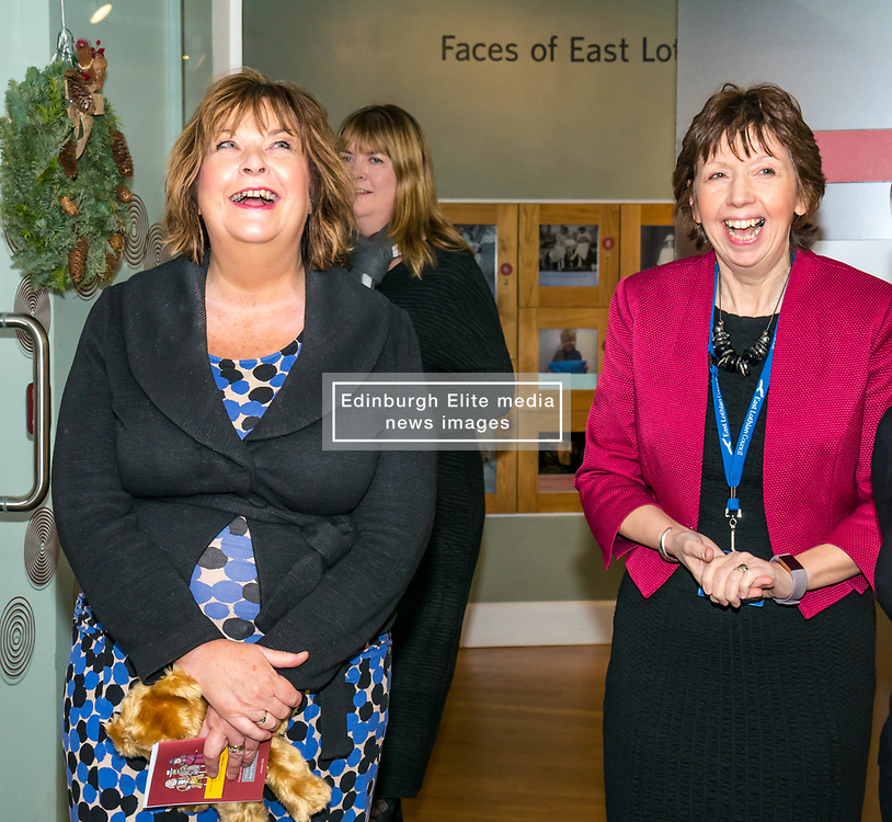 Pictured: Scottish Government Public Libraries Funding Announcement. Culture Minister Fiona Hyslop announces this year's successful bids to the £450,000 Public Library Improvement Fund (PLIF) at the John Grey Centre, Haddington Library, Haddington, East Lothian, Scotland, United Kingdom.  PLIF has been supporting innovative library projects since 2006 which help both individuals and communities. Fiona Hyslop and the Depute Chief Executive of East Lothian Council,  Monica Patterson. 13 December 2018  <br /> <br /> Sally Anderson | EdinburghElitemedia.co.uk