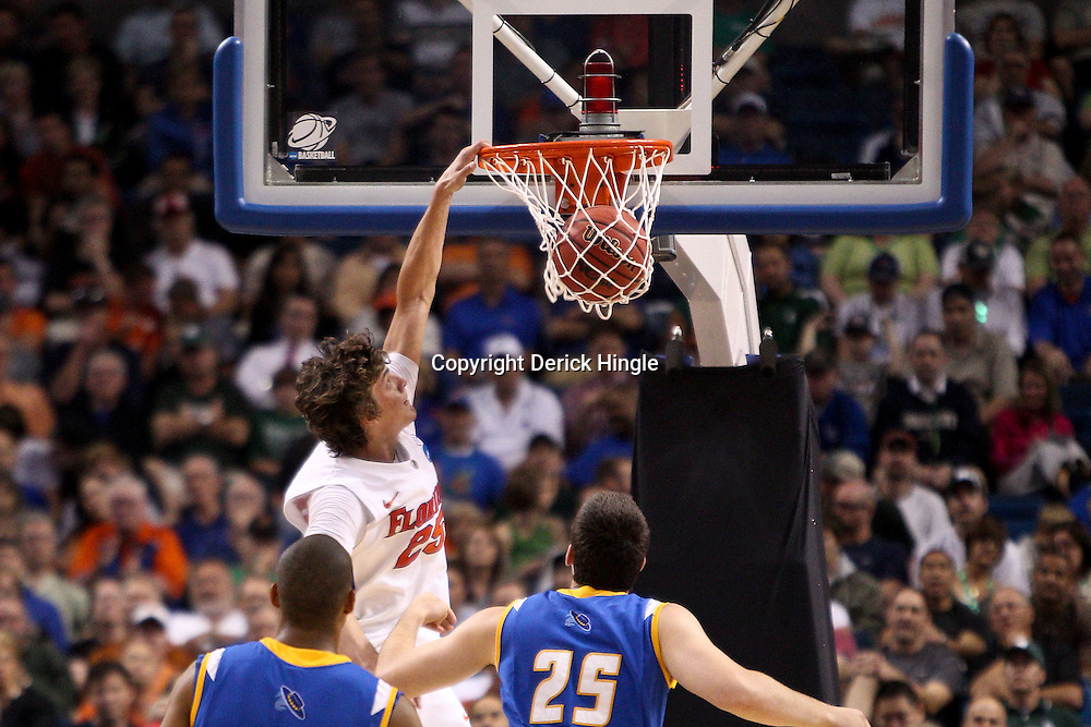 Mar 17, 2011; Tampa, FL, USA; Florida Gators forward Chandler Parsons (25) dunks against the UC Santa Barbara Gauchos during second half of the second round of the 2011 NCAA men's basketball tournament at the St. Pete Times Forum. Florida defeated UCSB 79-51.  Mandatory Credit: Derick E. Hingle