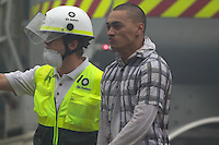 Topi Mery  as he emerges from the wreckage of the CTV building in Christchurch City Centre after five hours trapped in the rubble after a Powerful earth quack ripped through Christchurch, New Zealand on Tuesday lunch time killing at least 65 people as it brought down buildings, buckled roads and damaged churches and the Cities Cathedral. Photo Tim Clayton