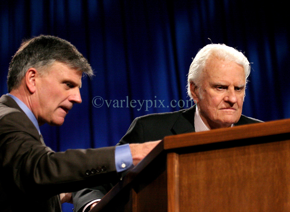 March 12th, 2006. New Orleans, Louisiana. <br /> Claiming this to be his last event preaching from the pulpit, the world's most famous evangelist, The Reverend Billy Graham, his son Franklin to the left prepares to address a capacity crowd at the New Orleans Arena as he brings his 'Celebration of Hope' weekend event to an end.<br /> Photo&copy;; Charlie Varley/varleypix.com