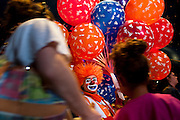 "Jahirt Bermudez, of Colombia, South America, who performs as Perolito the clown for the Cole Bros. Circus, sells ballons during intermission at a stop in Frederick Maryland. The Cole Bros. Circus of the Stars is celebrating its 127th season and bills itself as the ""World's Largest Circus Under The Big Top."""